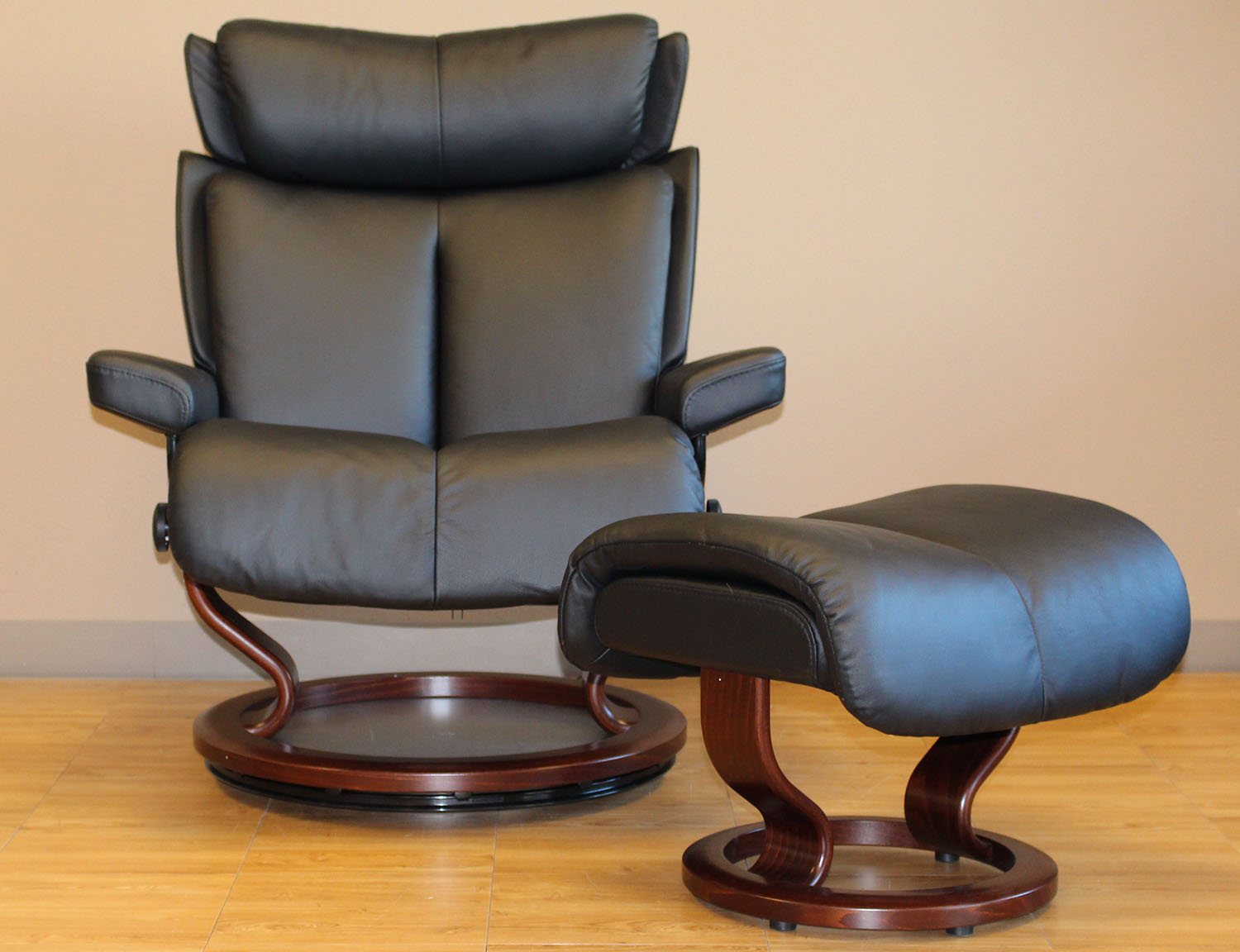 Stressless Magic Paloma Black Leather Recliner And Ottoman